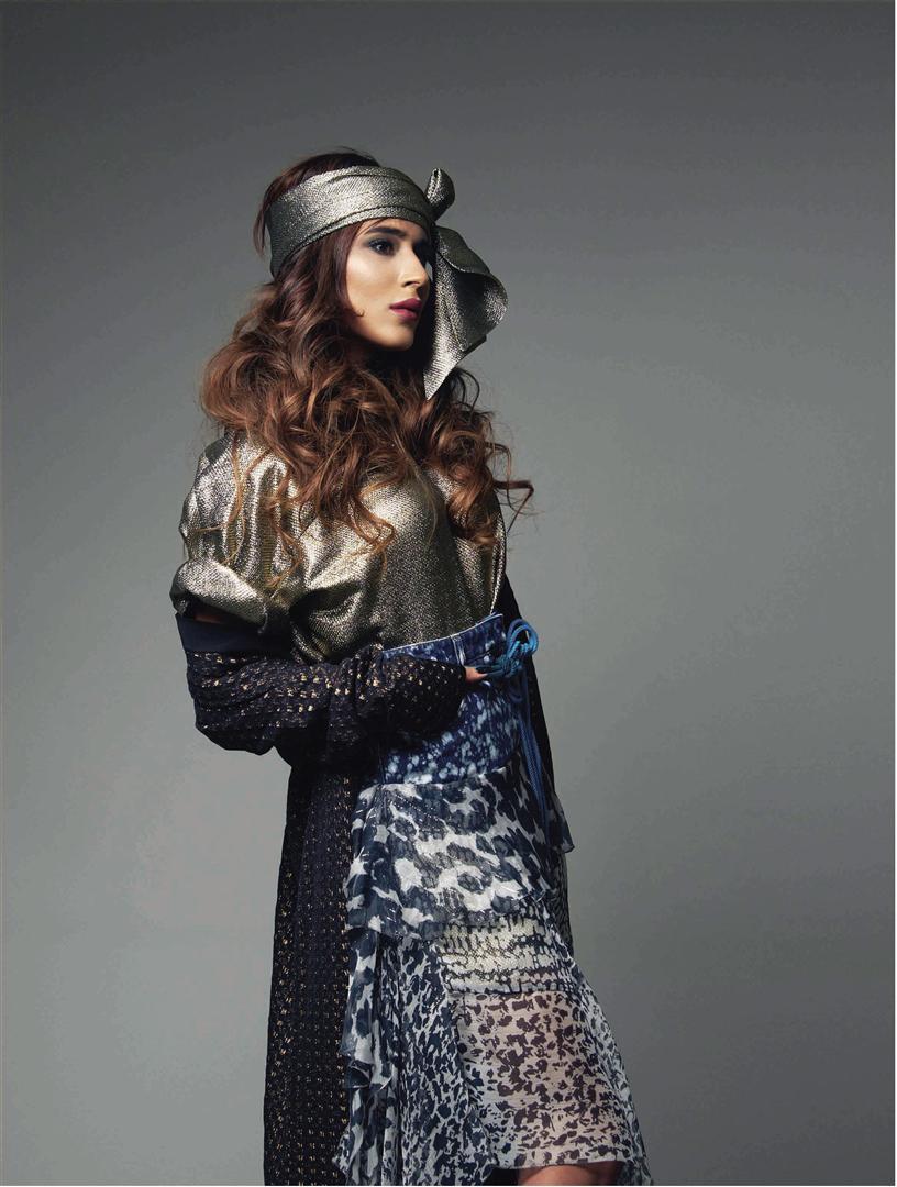Shirt & Skirt: Faith Connexion – Al Ostoura Thuraya Mall Coat: Alaïa – Thuraya Mall Belt: Lanvin – Thuraya Mall