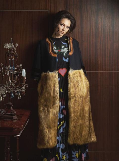 Coat: Dries Van Noten - Thuraya Mall Dress: Mary Katrantzou - Al Ostoura Thuraya Mall. Earrings: Ca & Lou - Al Ostoura Thuraya Mall & Al Ostoura The Avenues.