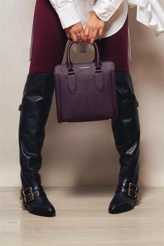 Boots: Chloé Bag: Alexander McQueen Trousers: Alaia Shirt: Nabil Nayal Rings: Randa Tabbah