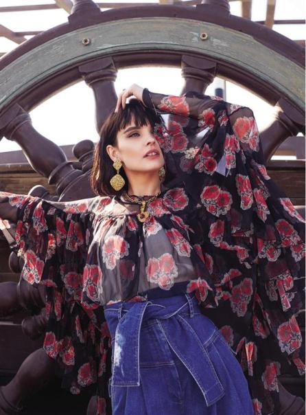 TOP: Alexander McQueen - Thuraya Mall TROUSERS: Sara Battaglia - Al Ostoura Thuraya Mall, Al Ostoura The Avenues EARRINGS & NECKLACE: Vintage Chanel - What Goes Around Comes Around Thuraya Mall
