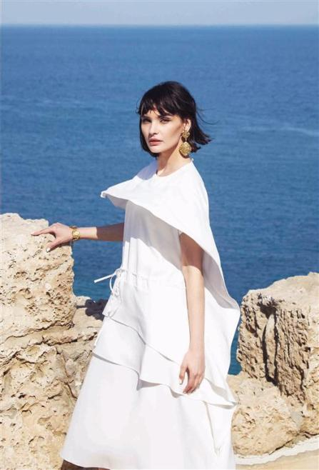 DRESS: Adeam - Al Ostoura Thuraya Mall Mezzanine BRACELET & EARRINGS: Vintage Chanel - What Goes Around Comes Around Thuraya Mall