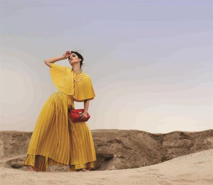 TOP: Sara Battaglia - Al Ostoura The Avenues, Al Ostoura Thuraya Mall BAG: Chloé - Thuraya Mall, Al Ostoura Salhiya Complex NECKLACE & BRACELET: Vintage Chanel - What Goes Around Comes Around Thuraya Mall