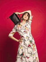 DRESS: ERDEM - Al Ostoura Thuraya Mall BAG: LOEWE - Al Ostoura Thuraya Mall EARRINGS: MARNI - Thuraya Mall
