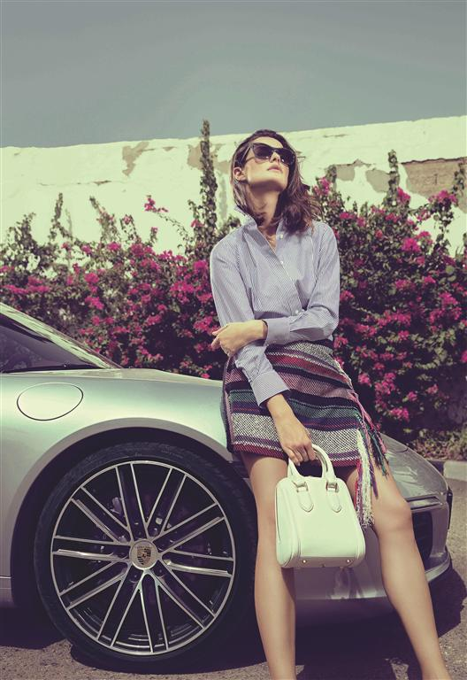 SHIRT & SKIRT: Sacai - Al Ostoura Thuraya Mall SUNGLASSES: Balenciaga - Thuraya Mall BAG: Alexander Mcqueen - Thuraya Mall