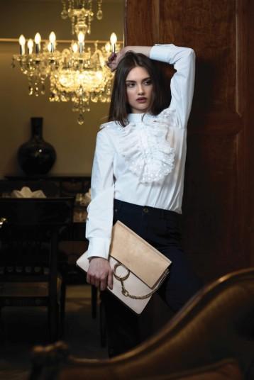 SHIRT AND BAG: Chloe JEANS: Chloe Thuraya Mall